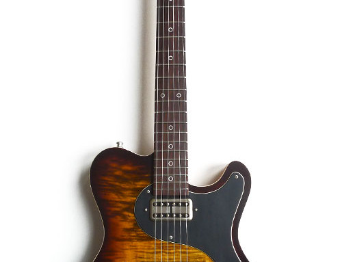 Nik Huber – Surfmeister – CurlyMaple Top – Tigereye Burst